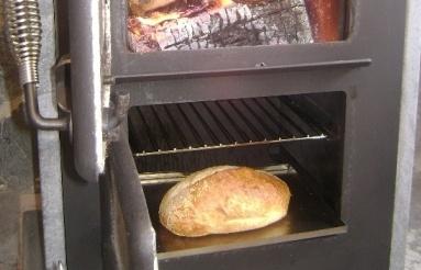 Bun baking underneath the fire.
