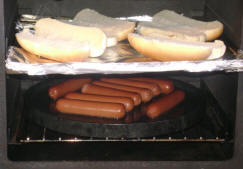 Cooking some dogs on the Bun Baker.